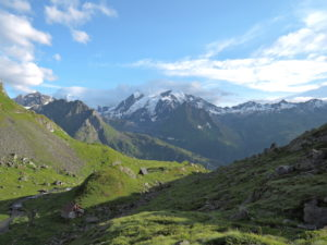 Trail to Fionnay from Louvie. Grand Combin covered in clouds in the distance