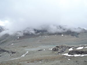 Col de Riedmatten on the other side of the glacial valley. Barely seen through the clouds
