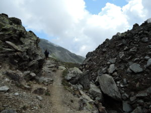 Ascending the narrow path to the left