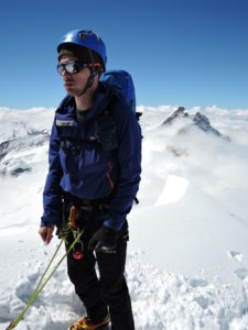 On the summit of Monch - Jungfrau behind